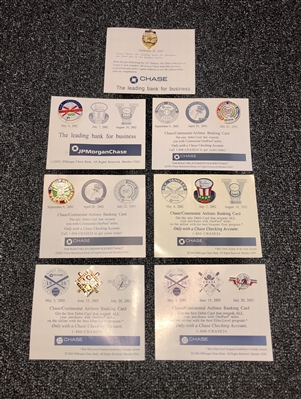Collection of 8 Game Day Giveaway Yankee World Series Press Pin replicas. Description of each series on the back